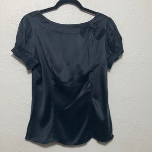 Bebe Boatneck Blouse with Bow and a Low Back Neckline